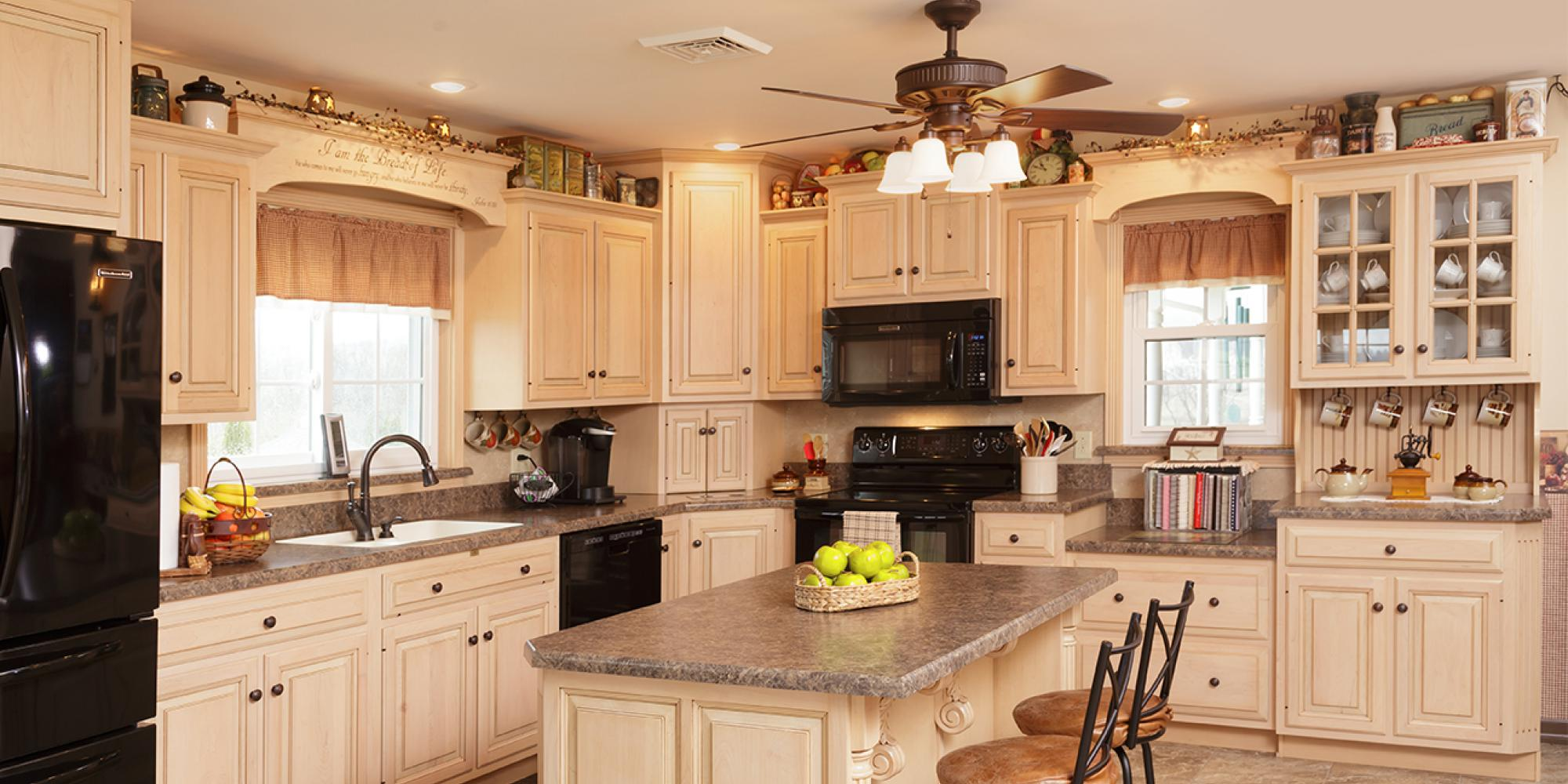 Hardwood kitchen including an island painted custom creme in Liverpool, Pennsylvania