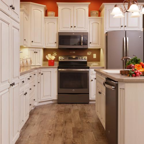 White hardwood kitchen cabinets with raised panel doors in Harrisburg, Pennsylvania