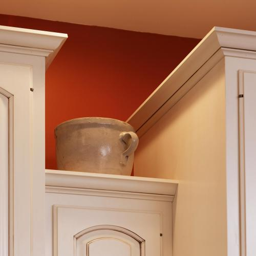 Solid wood kitchen cabinet showing rounded design in door panel and detailed edging