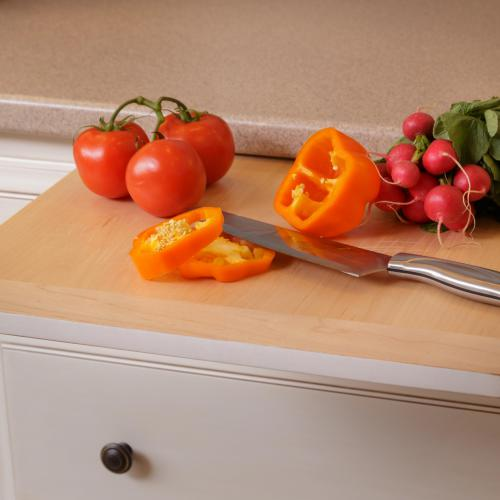 Built-in solid wood cutting board pulls out directly below the countertop