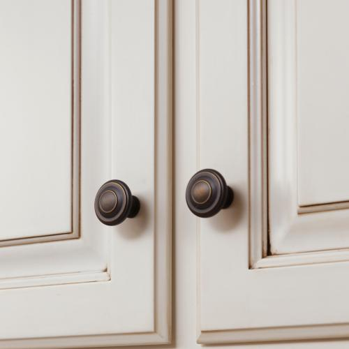 Close-up of kitchen cabinet doorknobs