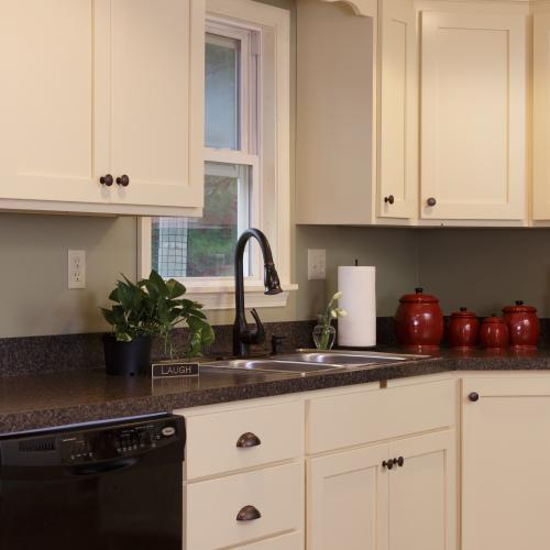 Custom-built solid wood kitchen cabinets surrounding the kitchen sink in Harrisburg, Pennsylvania