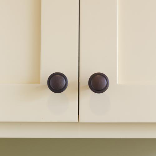 Close-up of recessed panel cupboard doors and Windermere doorknobs