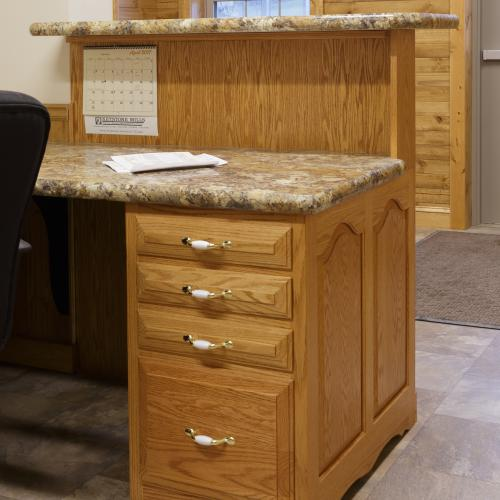 Granite design reception desk with drawers behind transaction counter built in Liverpool, PA