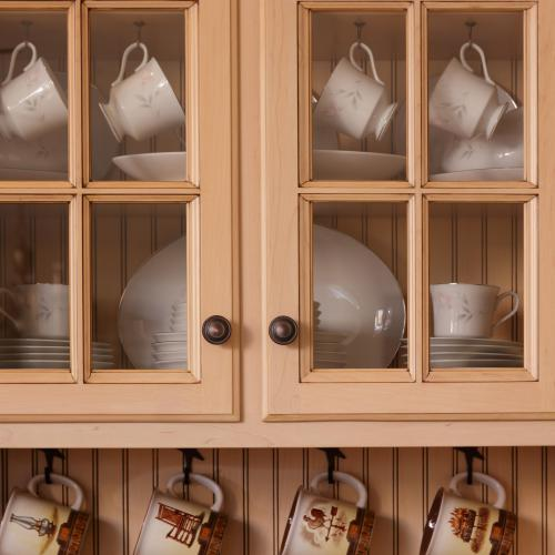 Close-up of kitchen display cabinet with glass doors