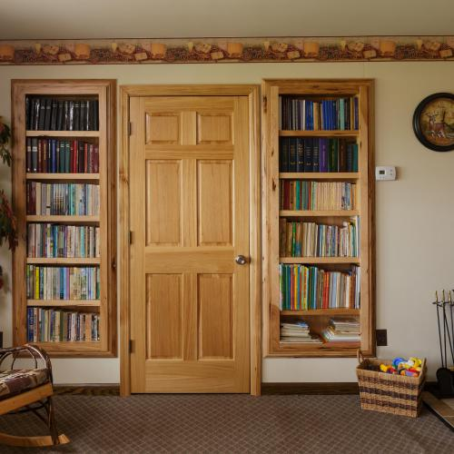 Solid wood bookcases built into the living room wall in Harrisburg Pennsylvania