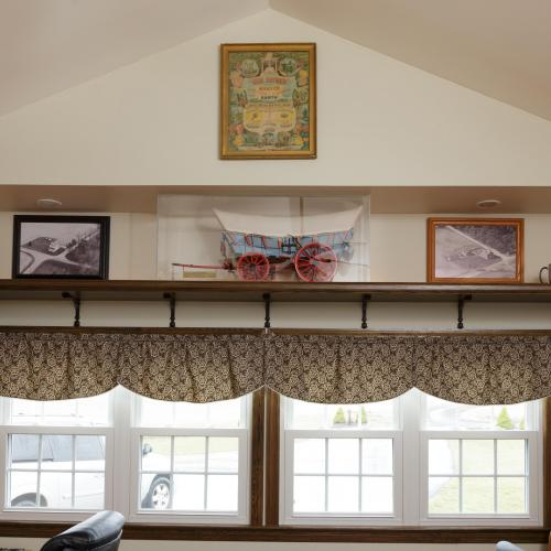 Hardwood display shelves built close to the ceiling crafted in Harrisburg, Pennsylvania