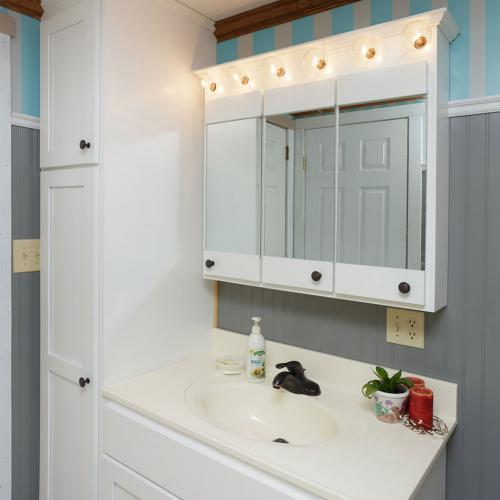 Solid wood white vanity with medicine cabinet mirrors and floor to ceiling linen closet built in Liverpool, PA